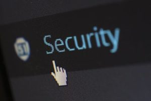 Mouse pointer pointing towards the word security